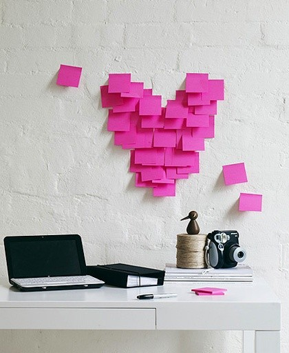 Image of a desk with heart post it notes